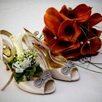 Bride's Shoes and Flowers Wedding Photographers Bristol and  Leicester