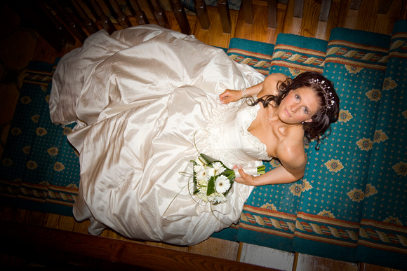 Bride lying on the Stairs Wedding Photography